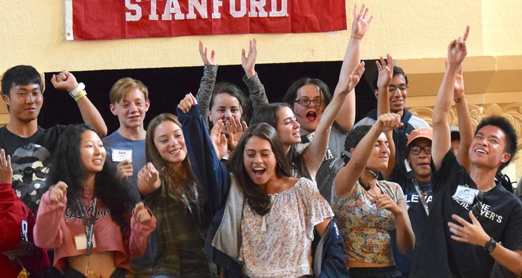 Students celebrate on stage at SuperCamp