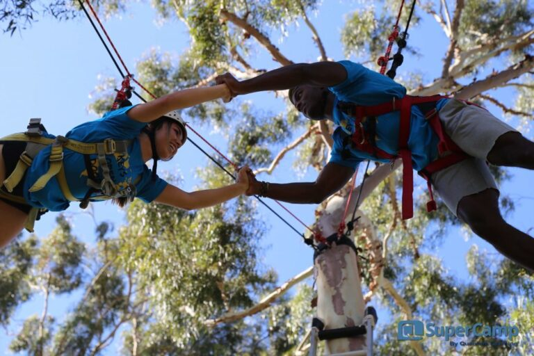 Two students on high ropes course